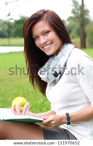 Beautiful portrait of a woman reading outdoors
