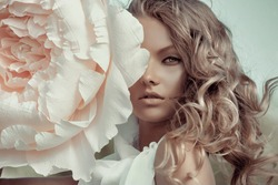 Beautiful portrait of a woman with big paper flowers