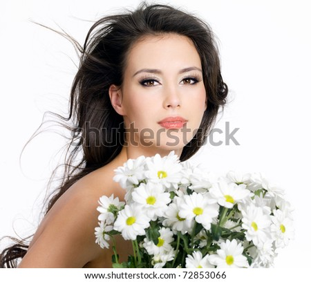 Beautiful portrait of young girl with bouquet of flowers - isolated on white background