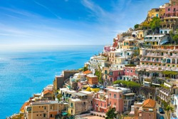 Beautiful Positano with hotels on hills leading down to coast, comfortable beaches and azure sea on Amalfi Coast in Campania, Italy. Amalfi coast is popular travel and holyday destination in Europe.