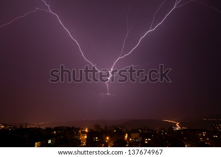 Beautiful powerful lightning over city, zipper and thunderstorm, dark sky with bright electrical flash, thunder and thunderbolt, bad weather concept