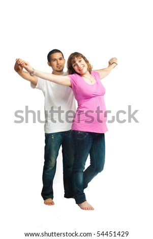 Beautiful pregnant woman and her husband are dancing.