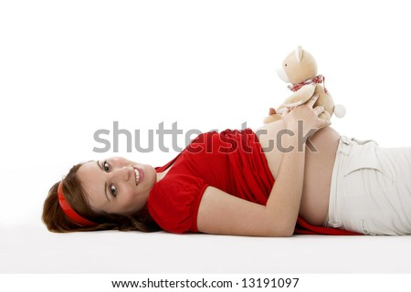 Beautiful pregnant woman with a teddy bear