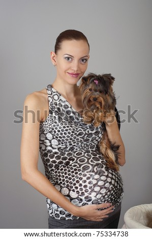 stock photo : beautiful pregnant women embracing dog. Save to a lightbox ▼