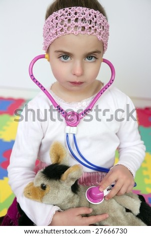 Beautiful preschooler girl pretending to be an animal doctor, stethoscope
