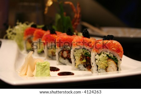 Beautiful presentation of sushi, with soft-shell crab, spicy tuna and black tobiko