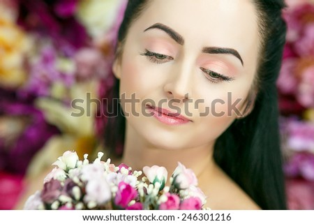 Beautiful pretty woman with white, pink, yellow flowers, colorful background. Perfect face, brunette, professional make up, natural beauty. 8 march card, present