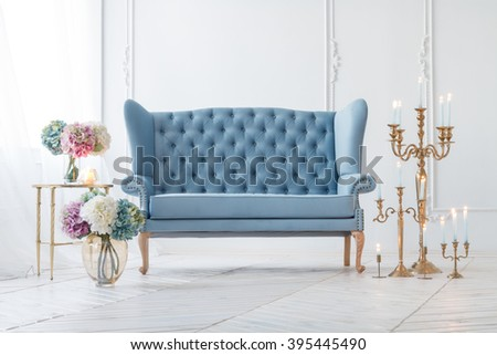 Beautiful Provance Living Room With Blue Sofa Near Table With Flowers And Candles