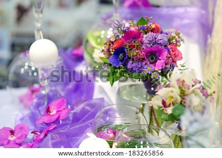 Beautiful purple flowers as a table decoration at wedding