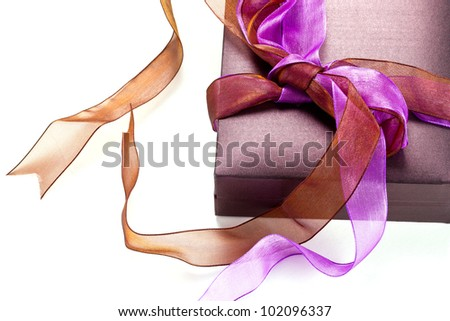 Beautiful purple gift box over white background