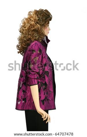 Beautiful purple silk dress on a dummy isolated on white