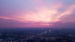 beautiful purple, sunset sky. and city view at dusk or night time coming up. Vanilla, pink, and violet color tone, give a sweet and romance feeling, cityscape background.