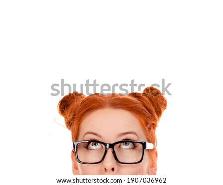 Beautiful puzzled woman in her 30s, looking upwards. Isolated on pure white background. Closeup portrait of a beautiful girl face above nose Stock photo ©