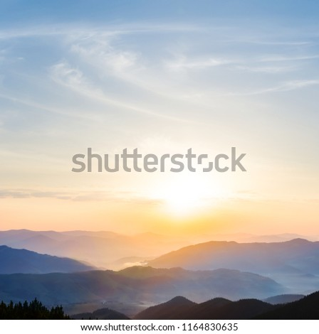 beautiful quiet sunset among the mountain valley with blue mist #1164830635