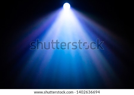 beautiful rainbow color spotlight wide lens projector with light beam for film movie and cinema at night . abstract smoke texture . screening for multimedia . black background . #1402636694