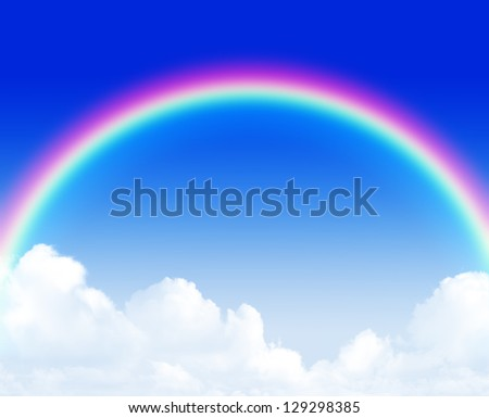 Beautiful rainbow over blue sky and clouds background