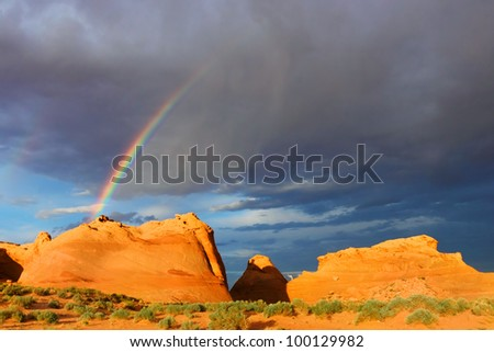 Beautiful rainbow over red rocks in Glen Canyon National Recreation Area, near Page, Arizona