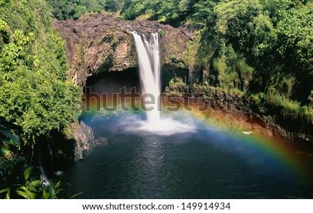 Beautiful Rainbow Waterfalls in Paradise on the Big Island in Hawaii. Wailua Waterfall near the island capital Lihue on the island of Kauai, Hawaii.  Zdjęcia stock ©