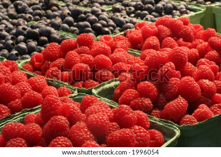 Beautiful raspberries and blueberries at the market.