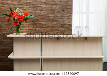 beautiful reception with a bouquet on a background window - stock photo