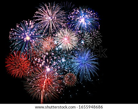 Beautiful red and blue fireworks display lights up the sky during night time celebration