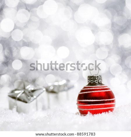 Beautiful red and silver Christmas decoration with snow in the background