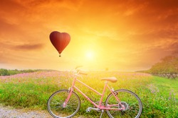 Beautiful Red balloon in the shape of a heart with bicycles at sunset
