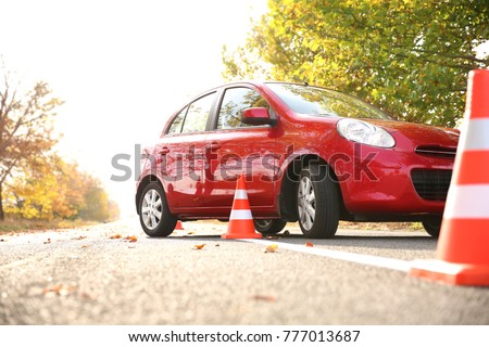 Beautiful red car and safety cones in driving school #777013687