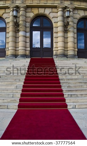 beautiful red carpet leading up old steps