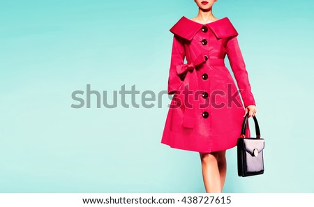 Beautiful red coat woman with black leather handbag. Fall winter fashion image.