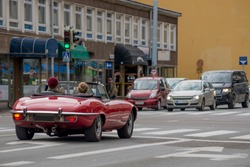 Beautiful red convertible car on the street in Turku, Finland