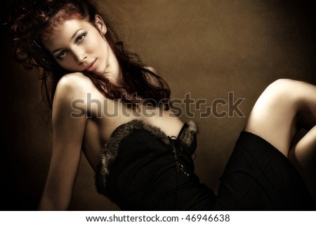 beautiful red hair sensual woman, studio shot
