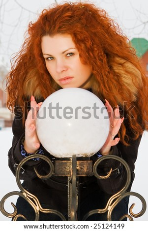 Beautiful red hair witch is practicing with sphere