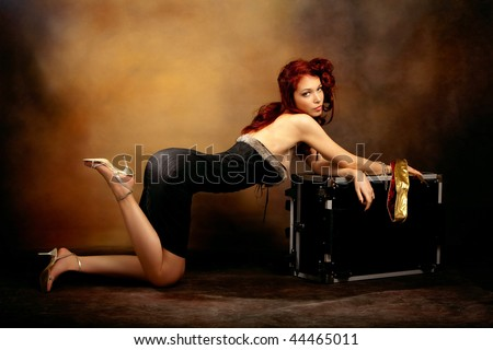 stock photo : beautiful red hair woman in sexy dress leaned on trunk,