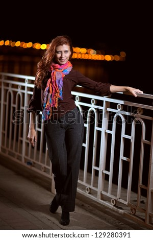 beautiful red-haired girl in the night city