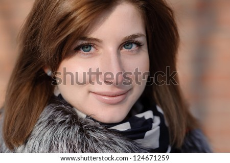 beautiful red-haired girl in winter clothes