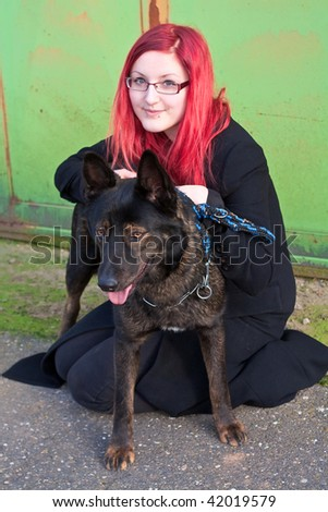 beautiful red haired girl with black dog