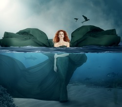 beautiful red haired goddess standing in the water.manipulated.