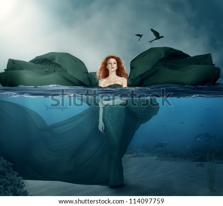 Stock Photo beautiful red haired goddess standing in the water.manipulated.