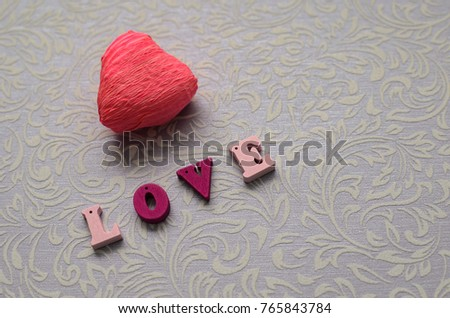 Beautiful red heart and multi-colored wooden Inscription love. #765843784