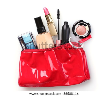 Beautiful red makeup bag and cosmetics isolated on white - stock photo