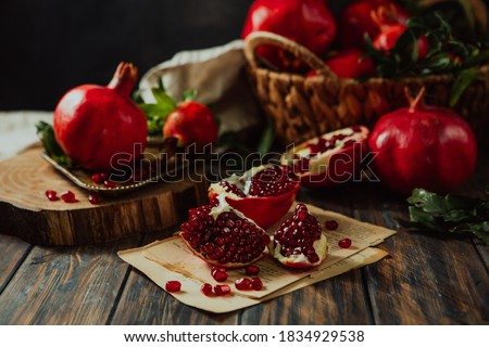 Beautiful red pomegranate fruit composition on a wooden background. Azerbaijan