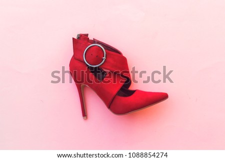 beautiful red pump hight heeled on pink background #1088854274