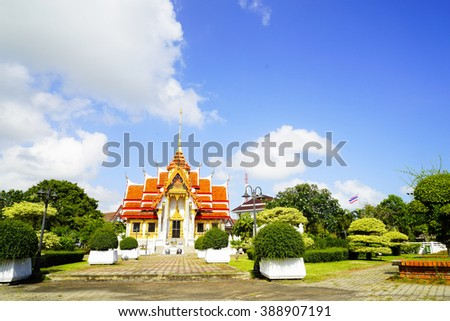 Beautiful red roof temple in Songkhla Thailand with blue sky background:select focus with shallow depth of field