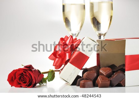 beautiful red rose, champagne  and chocolate  close up