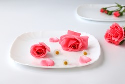 Beautiful red rose flowers on a white plate background with tender petals, bouquet, isolated. Blooming romantic pink roses - a symbol of love and celebration. Happy Valentine day, women day