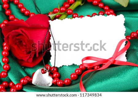 Beautiful red rose with heart pendant