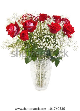 Beautiful red roses bouquet in a crystal vase isolated on white
