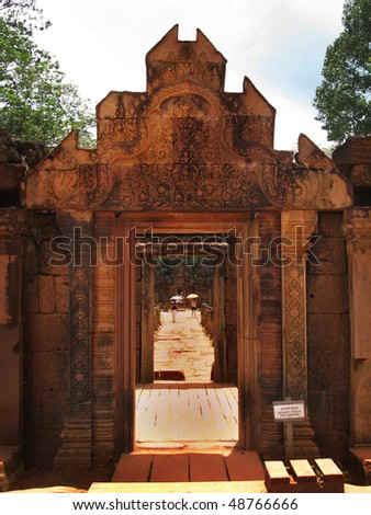 stock-photo-beautiful-red-sandstone-carvings-at-the-banteay-srei-temple-temple-of-women-near-angkor-wat-siem-48766666.jpg