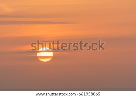 beautiful red sunrise over the ocean #661958065